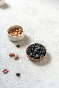 brown and black coffee beans on white ceramic bowl